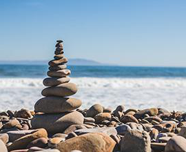 Stacked stones by beach