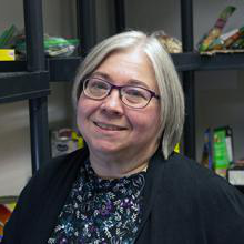 Cindy Warner, organizer of Le日bridge College's Food for Fines campaign.